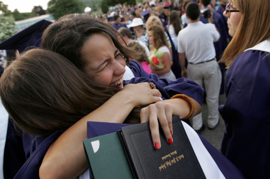 Graduate Michelle Virshup hugs friend Jenna Battista at the conclusion of commencement ceremonies at Platt High School Tuesday June 17, 2008. Virshup graduated as the #2 student in her class and also gave the salutatory address. (dave zajac photo)