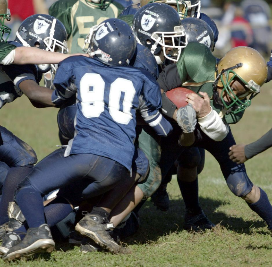 MERIDEN, Connecticut - Sunday, October 28, 2007 - A Waterbury Knights player is tackled by a group of Meriden Raiders defenders in a Pop Warner football game played on Sunday, Oct. 28 at Washington Park. Rob Beecher / Record-Journal