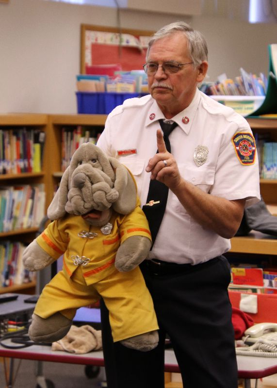 "Officer Tom Stange and his sidekick ""Wrinkles."""