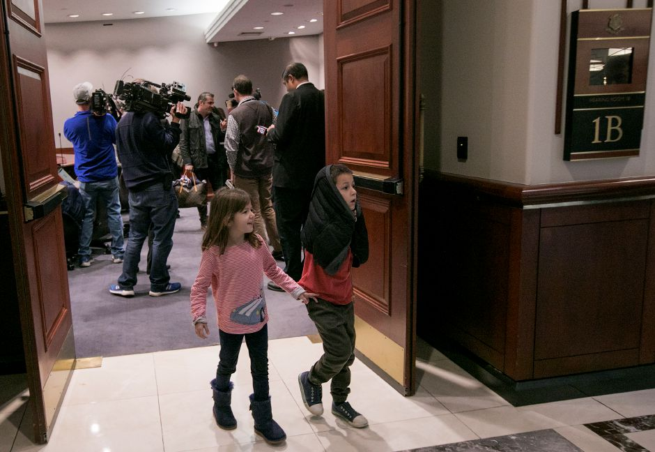 Katerina Rondos, 5, and brother, Niko, 7, exit a press conference at the Legislative Office Building in Hartford Monday, November 13, 2017. The Department of Homeland Security issued a forbearance that stated ICE won't act to deport their mother, Denada Rondos, while her appeal is being reviewed by the Second Circuit Court of Appeals. | Dave Zajac, Record-Journal