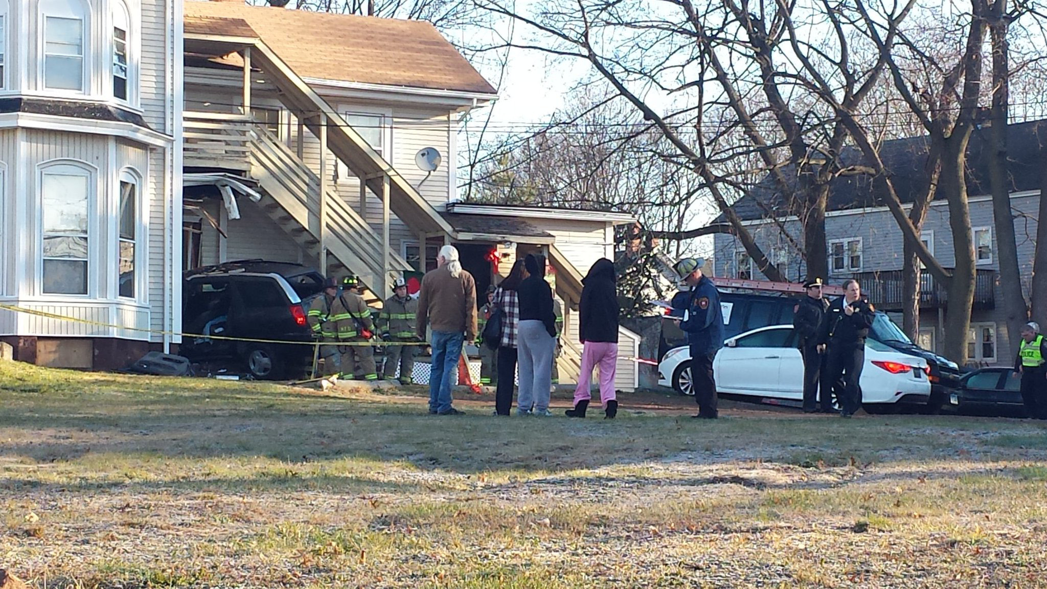 Emergency crews responded to the intersection of Broad and Wall streets Tuesday morning after a car crashed into a home. | Lauren Sievert, Record-Journal