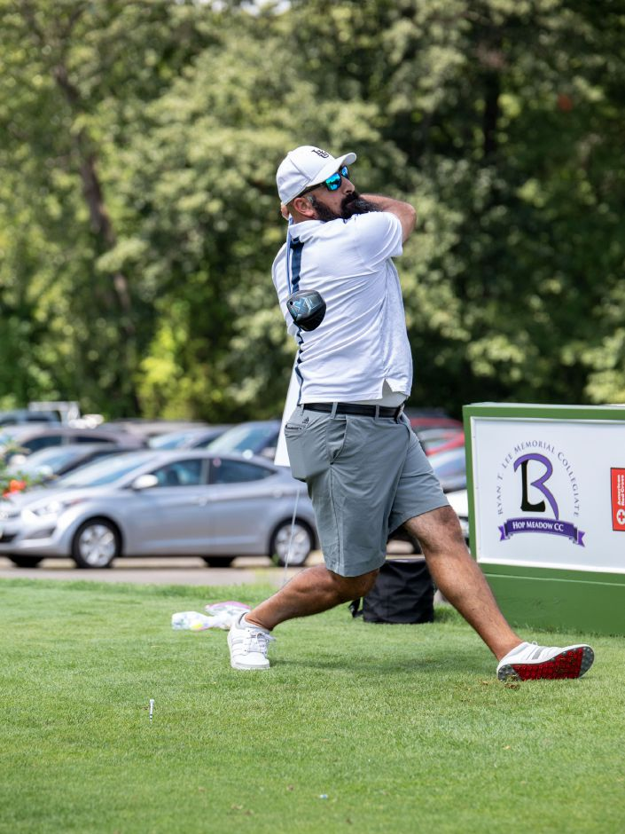 Mike Michaelides launches a drive at the the Ryan T. Lee Memorial Foundation