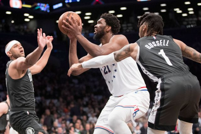 76ers center Joel Embiid (21) goes to the basket against the Nets' Jared Dudley during the first half of Saturday's NBA playoff game in Brooklyn, New York. Associated Press