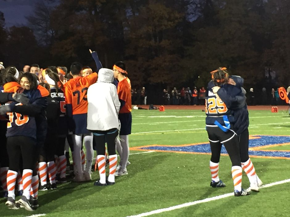 Lyman Hall powder puff players celebrate after winning the 46th annual Samaha Bowl on Wednesday at Fitzgerald Field at Lyman Hall. | Bailey Wright, Record-Journal