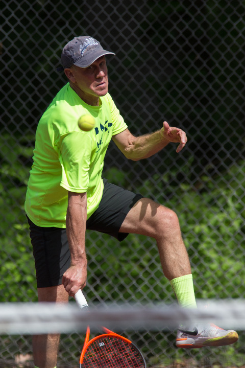 Todd Piker in the mixed B doubles final Sunday during the Wink Filipek Sr. Memorial Tennis tournament at Copper Valley Swim and Tennis Club in Cheshire Jun. 11, 2017 | Justin Weekes / For the Record-Journal
