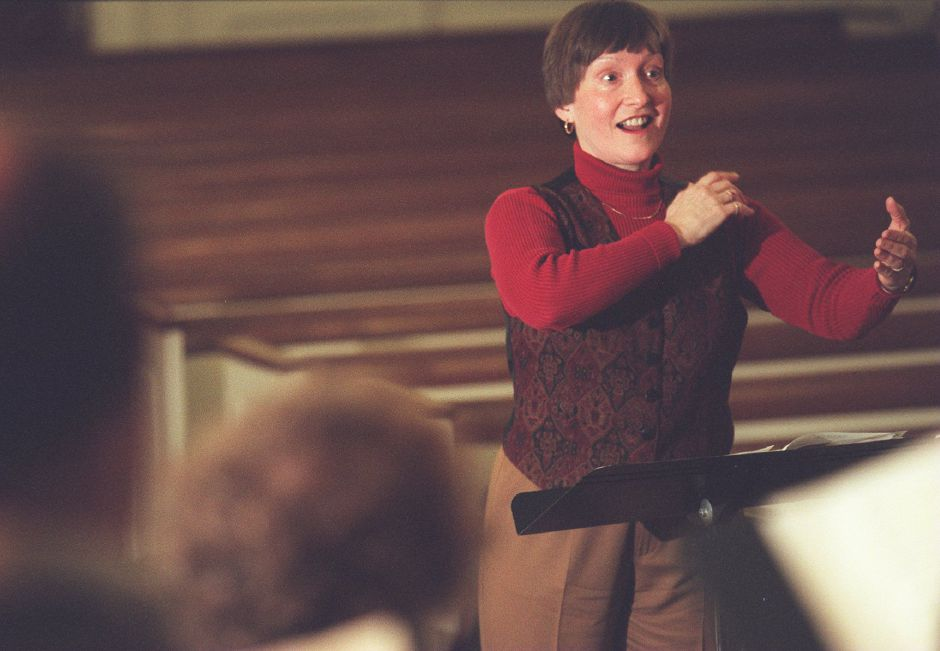 RJ file photo - Dorothy A. Barnhart, artistic director for Chorale Connecticut, conducts the choir during a rehearsal in meriden, Dec. 1998.