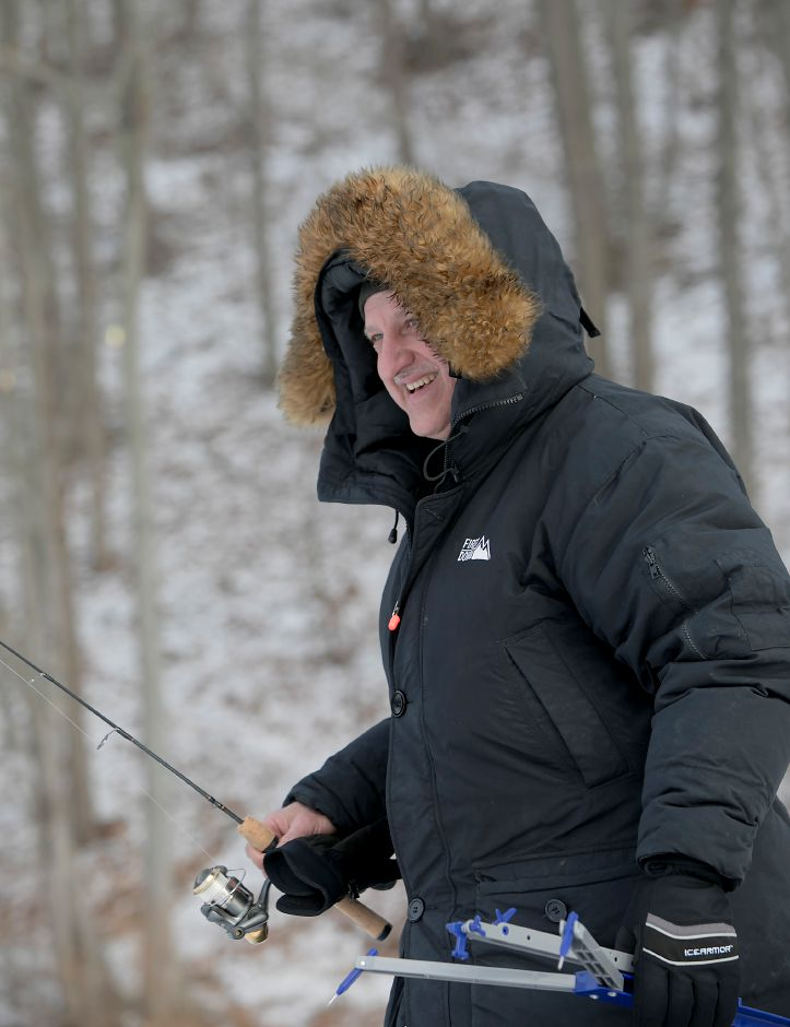 Mark Zukowski, of New Britain, braves bitter cold temperatures while ice-fishing Black Pond in Middlefield, Tuesday, Jan. 2, 2018. Dave Zajac, Record-Journal