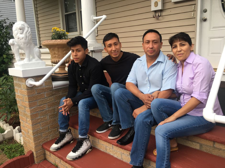 Brothers Erick and Jason Ramos, left, sit with their parents Franklin and Gioconda at their Cook Avenue home on  Aug. 10. Franklin and Gioconda are allowed to remain in the country while their case is examined.File photo, Record-Journal