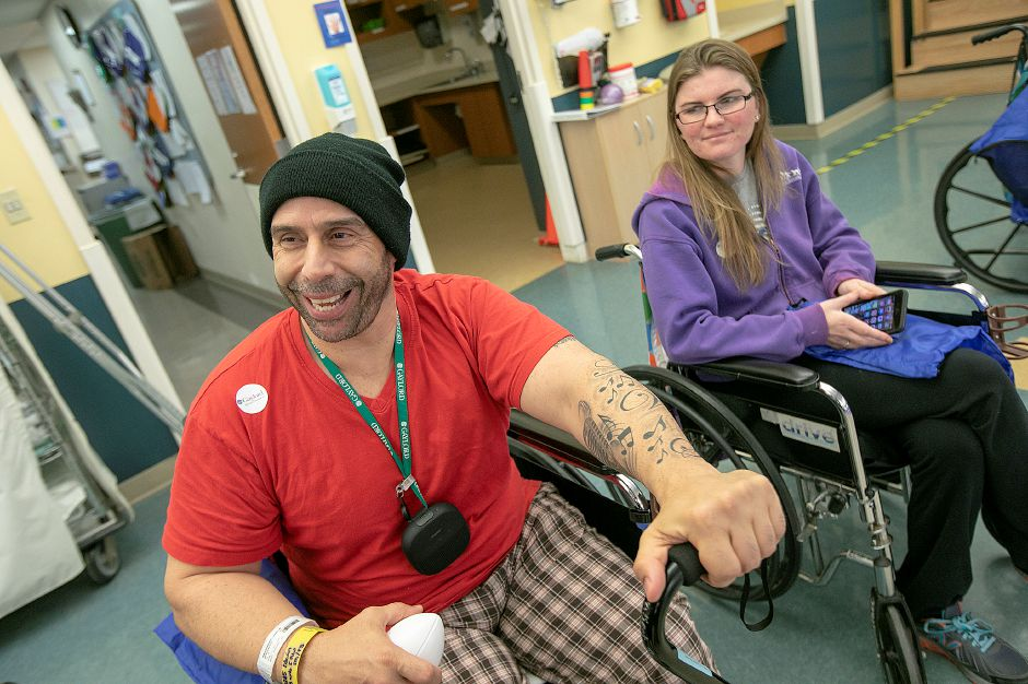 Patients Edwin Hernandez, of Meriden, and Lindsay Hermanski, of Pittsfield Mass., wait to greet players during the Walter Camp Football Foundation event at Gaylord Hospital, Fri., Jan. 11, 2019. Dave Zajac, Record-Journal