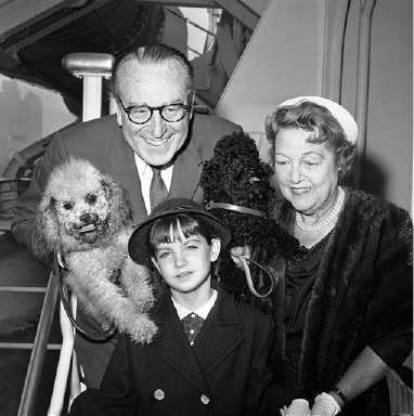 Silent screen star Harold Lloyd and his wife are seen August 29, 1960, with their granddaughter Suzanne Guasti, 8, as they arrived in New York aboard the liner United States, returning from a European vacation. (AP Photo/Anthony Camerano.)