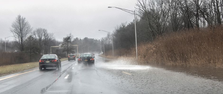 Flood waters slow traffic on Route 15 south in Meriden, Fri., Dec. 21, 2018. Dave Zajac, Record-Journal
