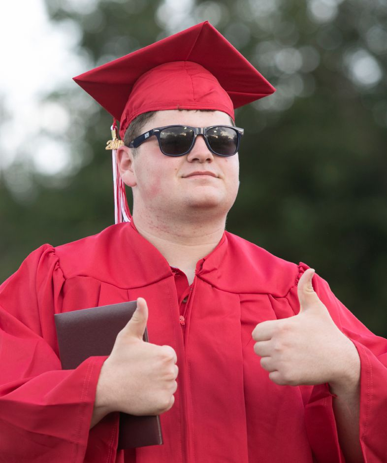 Graduate Christian Beyerle gives a thumbs-up after receiving his diploma during graduation ceremonies at Cheshire High School, Thursday, June 21, 2018. Dave Zajac, Record-Journal