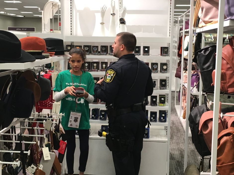 "Police officers helped kids shop for holiday gifts at Target during the sixth annual ""Shop With a Cop"" event in Southington on Tuesday, Dec. 11, 2018. (Ryan Chichester, Record-Journal staff)"