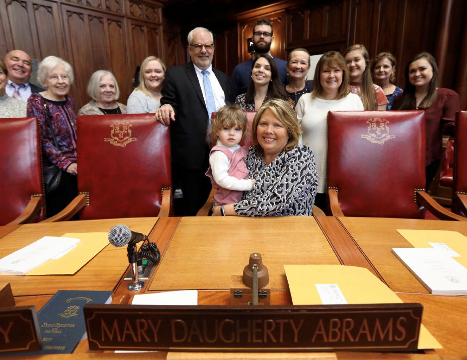 Mary Daugherty Abrams, surrounded by family, holds granddaughter Rose Thomas, 2, in her seat in the Senate, Wed. Jan. 9, 2019. Dave Zajac, Record-Journal