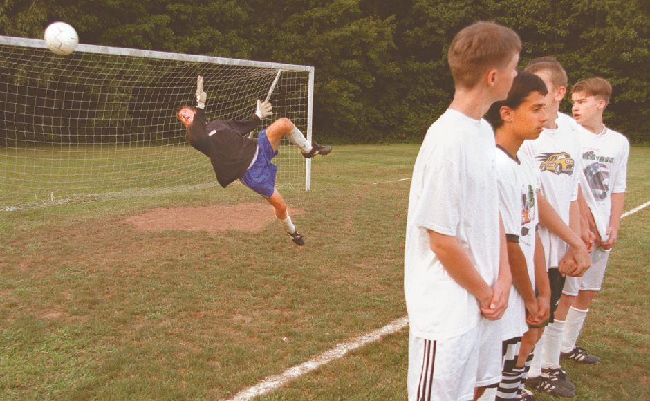RJ file photo - Goalie Ken Lewis of the Wallingford Blizzard leaps at a shot as his teammates form a defensive wall in practice for the TWIST tournament, Aug. 1998.