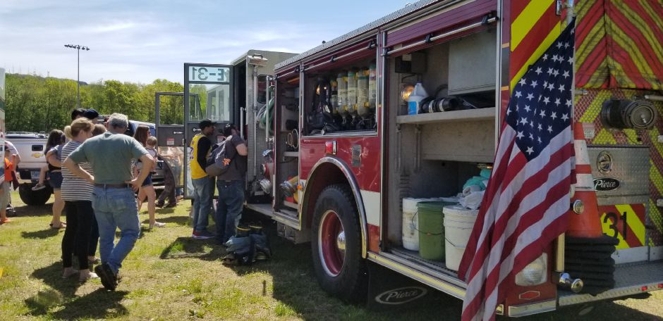 Children and their parents lined up to see the inside of a firetruck at the 17th annual Touch-a-Truck event at the Southington Drive-In, at 995 Meriden-Waterbury Turnpike, on Saturday, May 18, 2019. Photos by Jeniece Roman, Record-Journal