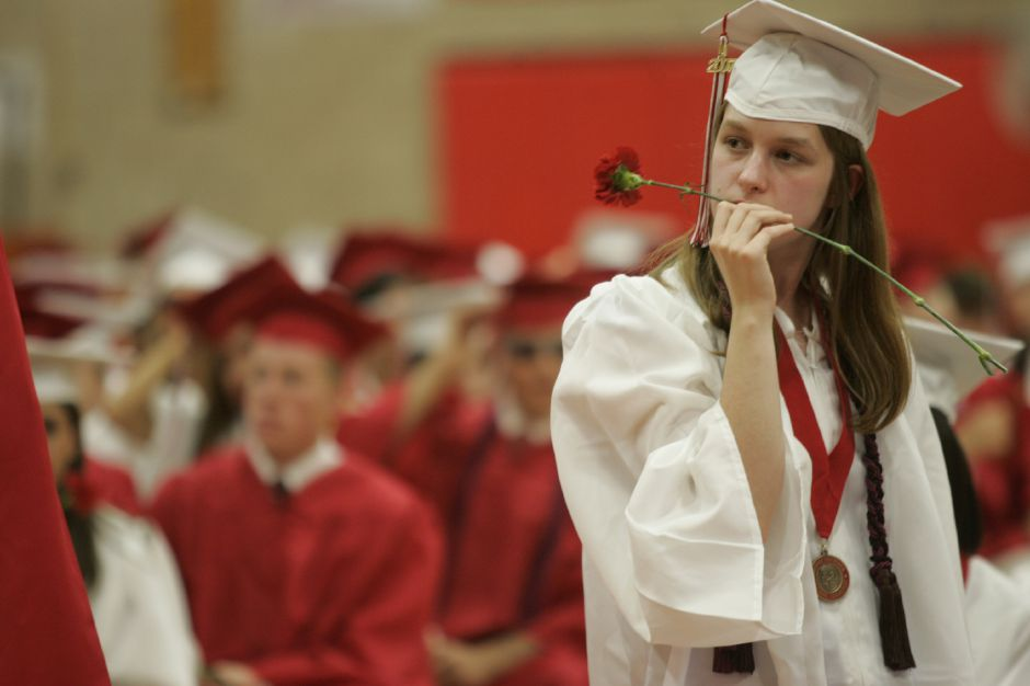 Graduate Ashley McKee holds a flower before the start of commencement ceremonies at Cheshire High School June 20, 2007. (dave zajac photo)