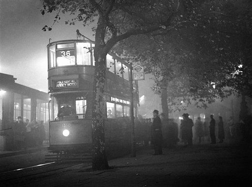 Riverside curtained - the fog in London persisted throughout the day. Dreary fog scene on the Thames Embankment at Blackfriars at 5.15 p.m., in London, United Kingdom on Oct. 25, 1938, with stationary tramway car and hazy figures. (AP Photo/Wool)