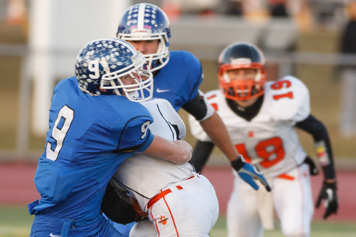Southington's Alexander Jamele (9) tackles Ridgefield's Jack Boscia (4) during the class LL semifinal Saturday at Ken Strong Stadium in West Haven December,7 2013 | Justin Weekes / For the Record-Journal
