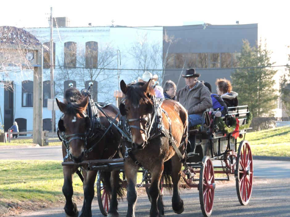 A horse-drawn carriage carries guests along the linear trail in Wallingford during the 2015 Holiday Celebration on the Linear Trail. | Christine Huskes, Special to the Record-Journal