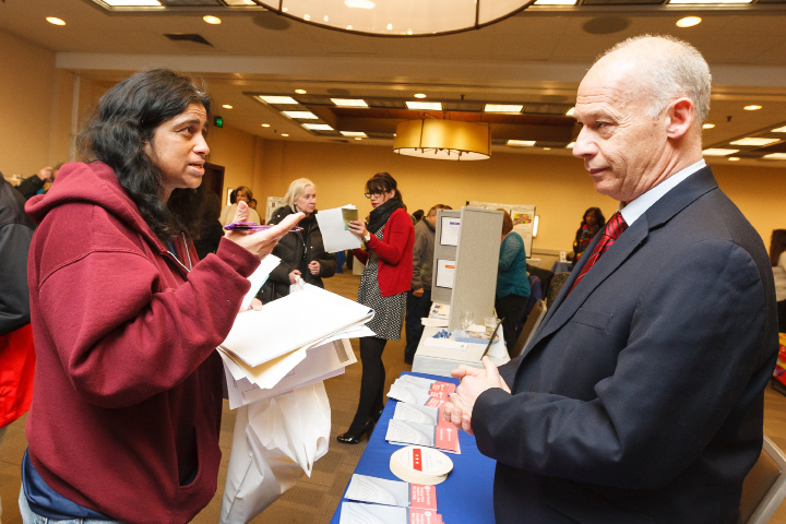Paula Meyers left of Bolton speaks with Social Security distric manager Paul Gilfillan of Bethany during the post high school transition expo Wednesday at the Four Points Sheraton in Meriden March,26 2014 © Justin Weekes 2014 All rights reserved Not for distribution to third party