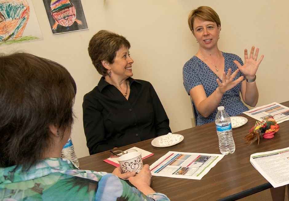 Ramona Burkey, director of the Cheshire Public Library, right, speaks next to Deb Rutter, deputy director of Cheshire Public Library, center, and Joan Pilarczyk, Artsplace director, during a meeting at Artsplace in Cheshire, Wednesday, May 9, 2018. Burkey has taken a position as director of the Russell Library in Middletown. Artsplace is a department subset of the Cheshire Public Library. Dave Zajac, Record-Journal