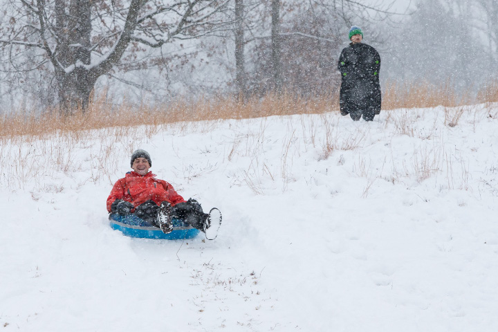 Will Morris of Wallingford takes a slide on a tube at Choate Rosemary Hall in Wallingford Saturday during a winter storm  Dec. 17, 2016 | Justin Weekes / For the Record-Journal