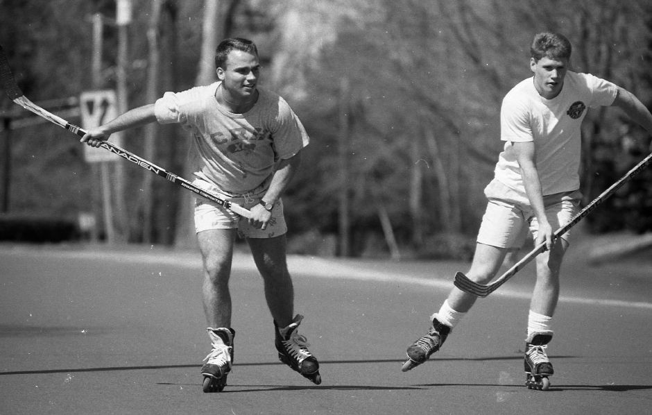 RJ file photo - T.J. Courtney, 19, and Chris Clancy, 18, skate down North Main Street in Wallingford April 20, 1989 on roller blades while carrying their hockey sticks. They are members of the Choate Rosemary Hall hockey team.