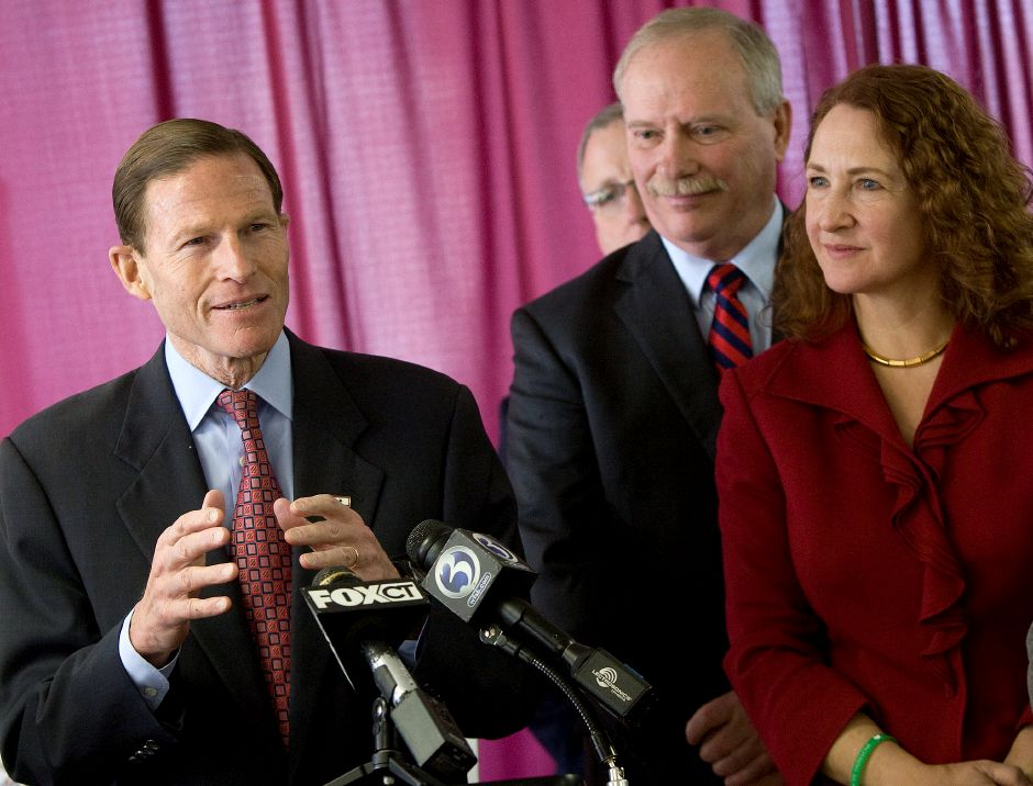 U.S. Sen. Richard Blumenthal speaks during a press conference at the Meriden Chamber of Commerce to announce the award of a $2.46 million federal grant to alleviate flooding issues in Meriden, Thursday, March 20, 2014. At right are City Manager Lawrence J. Kendzior and Congresswoman Elizabeth Esty. U.S. Sen. Chris Murphy and several city officials were also in attendance. | Dave Zajac / Record-Journal