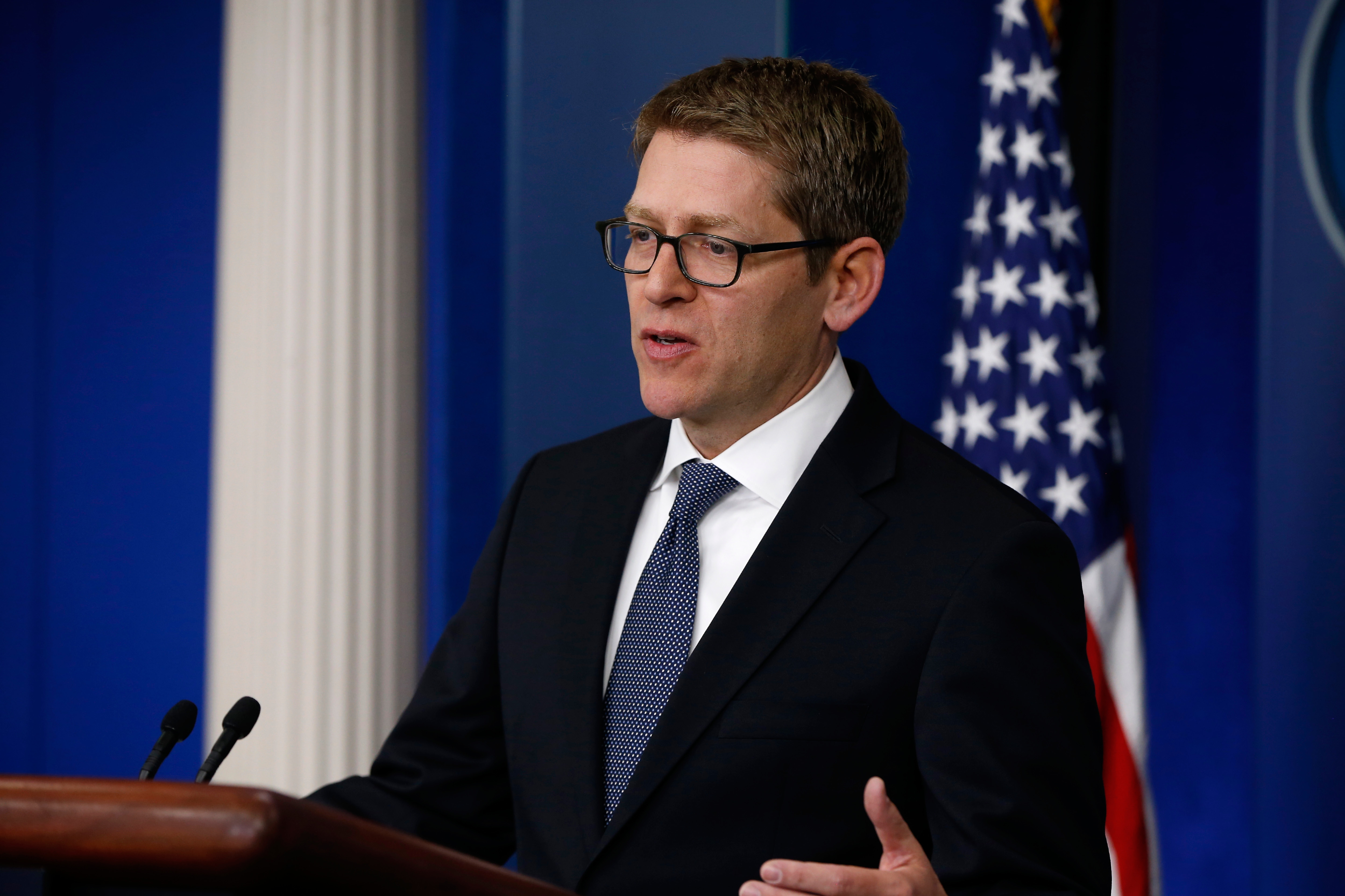 White House press secretary Jay Carney speaks to reporters at the daily press briefing, Friday, April 11, 2014, at the White House in Washington. The US, in a rare diplomatic rebuke, will not grant a visa to Tehran