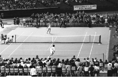 Billie Jean King displays her winning form as she goes low to return a volley by Bobby Riggs in their winner take all $100,000 match in the Astrodome in Houston, Texas on Thursday, Sept. 21, 1973. Ms. King defeated Riggs in the well publicized match, 6-4, 6-3, 6-3. (AP Photo)