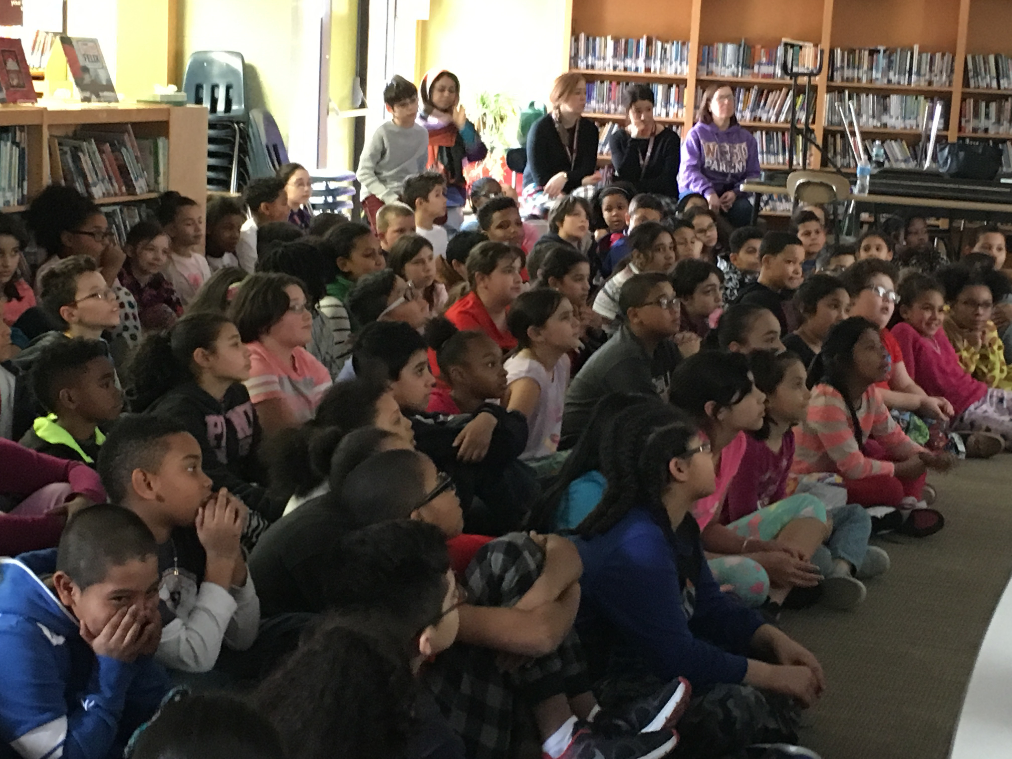 Casimir Pulaski Elementary School fourth-graders listen to a presentation on Meriden history by seventh-graders from Saint Joseph School on Friday, March 3, 2017. | Lauren Takores, Record-Journal