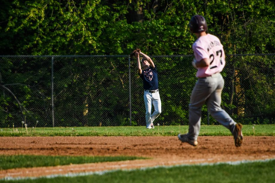 Brennan Toussaint catches a fly ball hit by Sheehan's Evan Wilkinson on Friday night at Pat Wall Field. | Jim McGovern, Special to the Record-Journal