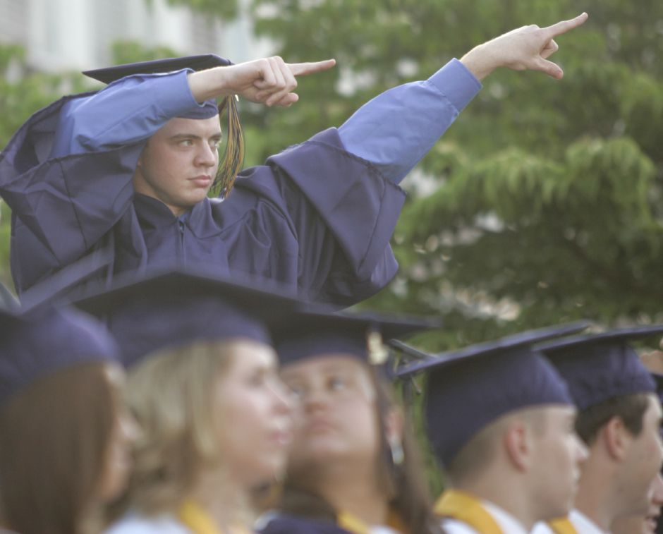 Graduate Ryan Sullivan answers to applause while walking the stage to receive his diploma during commencement ceremonies at Platt High School June 18, 2007. (dave zajac photo)