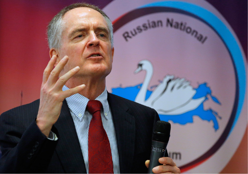 "FILE - In a March 22, 2015 file photo, U.S. writer Jared Taylor, author of the book ""White Identity"" speaks during the International Russian Conservative Forum in St.Petersburg, Russia. Taylor, a Yale University-educated, self-described ""race realist, "" runs the New Century Foundation. The federal government has allowed four groups at the forefront of the white nationalist movement, including the New Century Foundation, to register as charities and raise more than $7.8 million in tax-deductible donations over the past decade, according to an Associated Press review. (AP Photo/Dmitry Lovetsky, File)"