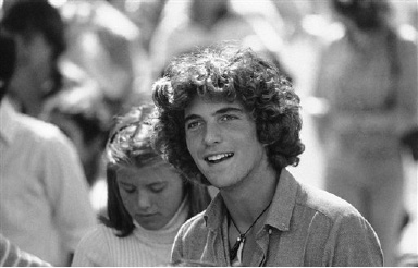 John Kennedy Jr. waits in registration line at Brown University in Providence, Rhode Island on Sept. 10, 1979 to register for his first year of college. Kennedy was dropped off at school by his mother Jacqueline Kennedy Onassis at his dorm room on the Brown campus. (AP Photo/Constance Brown)