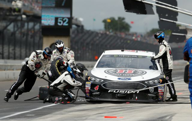 The car driven by NASCAR Cup Series driver Kevin Harvick (4) is serviced on a pit stop during the NASCAR Brickyard 400 auto race at Indianapolis Motor Speedway, in Indianapolis Monday, Sept. 10, 2018. (AP Photo/Rob Baker)