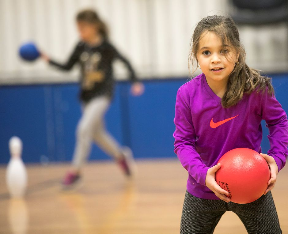 Natalie DiAngelo, 8, plays a game of bowling pin dodge ball with her third-grade classmates during a physical education class at Rock Hill Elementary School in Wallingford, Thursday, Jan. 11, 2018. Rock Hill Elementary School is competing for a $25,000 grant that would go to purchasing indoor and outdoor fitness equipment. Dave Zajac, Record-Journal