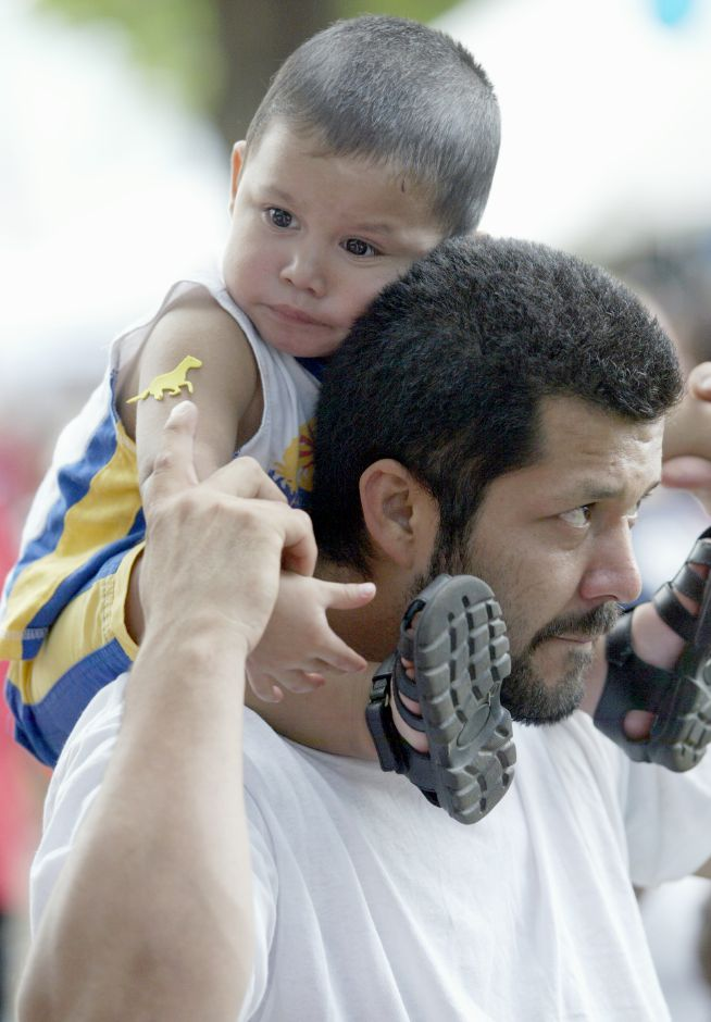 MERIDEN, Connecticut - Tuesday, August 5, 2008 - Sixto (CQ) Munoz 1, rests on his father Jose Munoz shoulders during the National Night Out party at City Park on Tuesday, August 5, 2008. Rob Beecher / Record-Journal