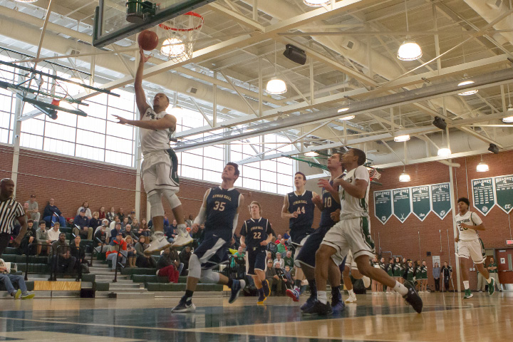 Maloney's Alejandro Ortiz puts in a layup off a steal against Lyman Hall Saturday at the newly-dedicated Norb Fahey and Howie Hewitt court at Maloney High School in Meriden. | Justin Weekes, Special to the Record-Journal