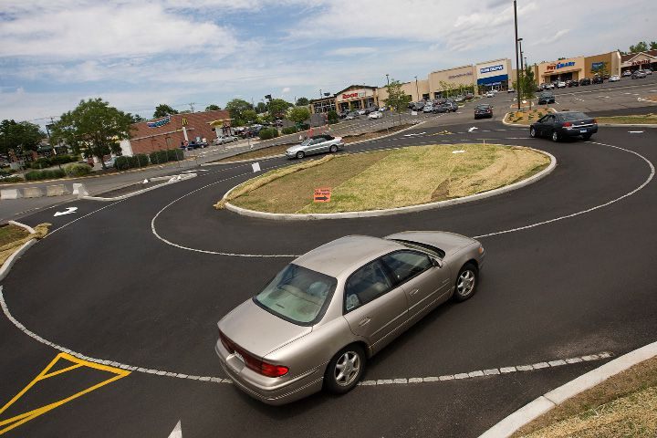 Traffic proceeds through a new roundabout at Townline Plaza in Meriden, Wednesday, July 9, 2014. The parking lot is getting a makeover, in hopes that new roundabouts will ease the flow of traffic in the shopping plaza. | Dave Zajac / Record-Journal