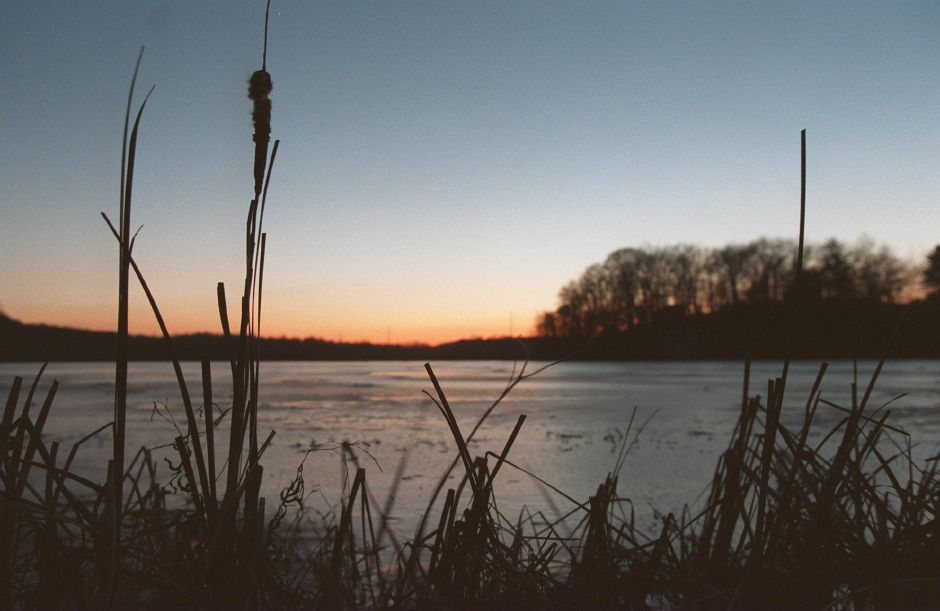 RJ file photo - As the sun sets behind Black Pond in Middlefield Jan. 11, 1999, the temperature drops and the freezing lake groans and pops as the ice expands on the lake