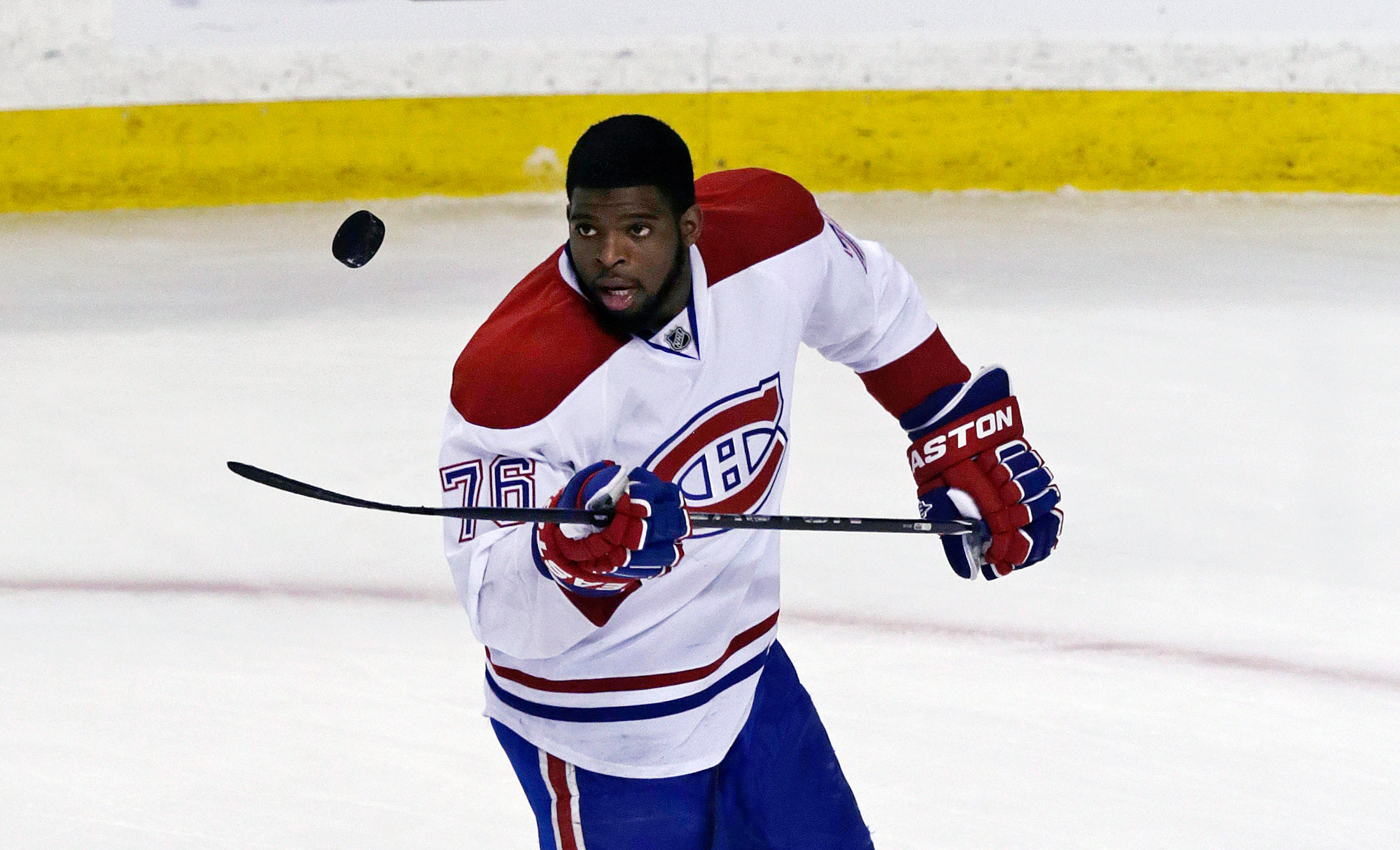 Montreal Canadiens defenseman P.K. Subban flips the puck prior to facing the Boston Bruins in Game 2 in the second-round of a Stanley Cup hockey playoff series in Boston, Saturday, May 3, 2014. (AP Photo/Charles Krupa)