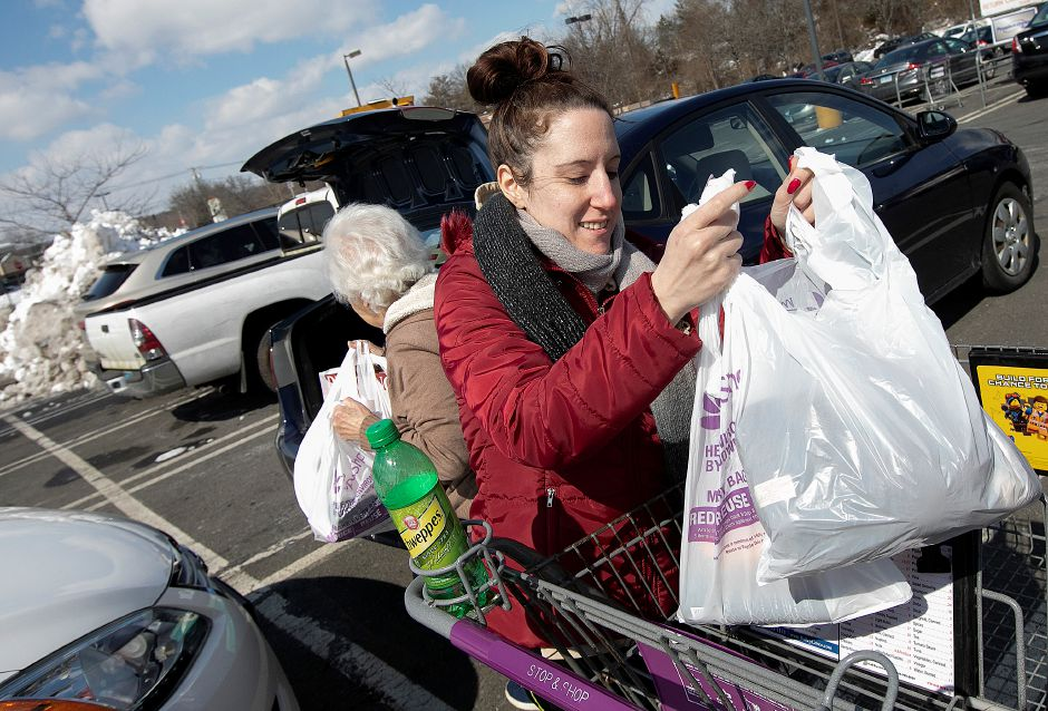 Christina Fitch, of Wallingford, helps grandmother Connie Campoli, of Wallingford, with her groceries after shopping at Stop & Shop in Wallingford, Thurs., March 7, 2019. Dave Zajac, Record-Journal