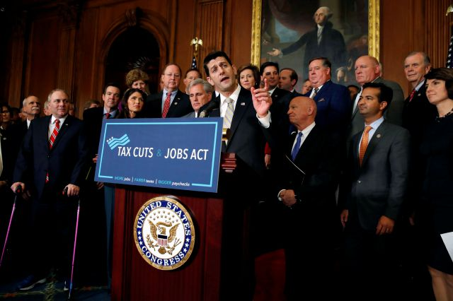 FILE - In this Thursday, Nov. 16, 2017 file photo, House Speaker Paul Ryan of Wis., joined by House Republicans, speaks to the media following a vote on tax reform, on Capitol Hill in Washington.  A popular deduction targeted in the GOP's overhaul of the tax code is used by more than a quarter of all filers in a majority of states, including many led by Republicans where some residents eventually could see their federal tax bills rise.  (AP Photo/Jacquelyn Martin, File)