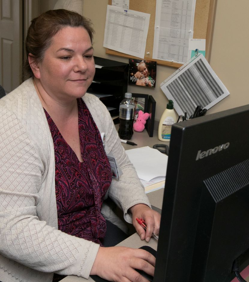 Francine Casarella, medical assistant, works at her desk at Hartford HealthCare