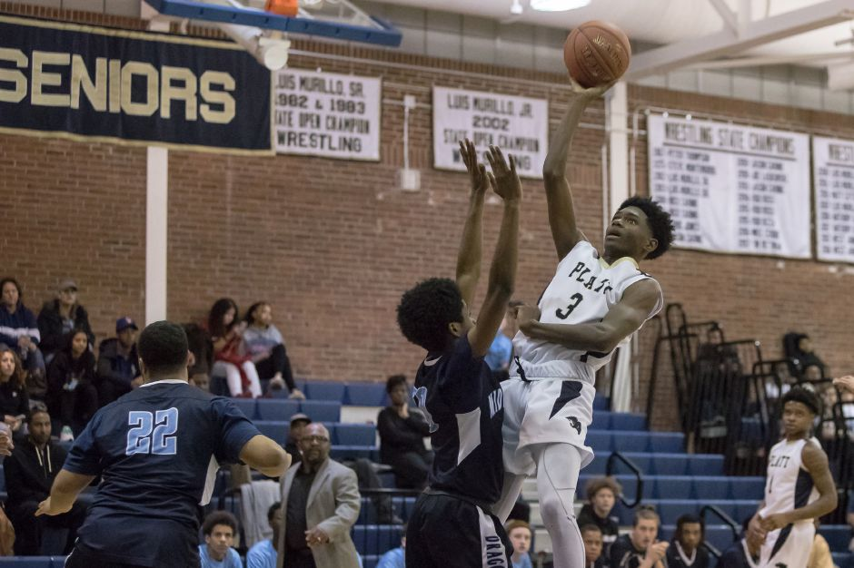 Platt senior Malcolm Andrews puts in a jumper for two of his 13 points on the night.