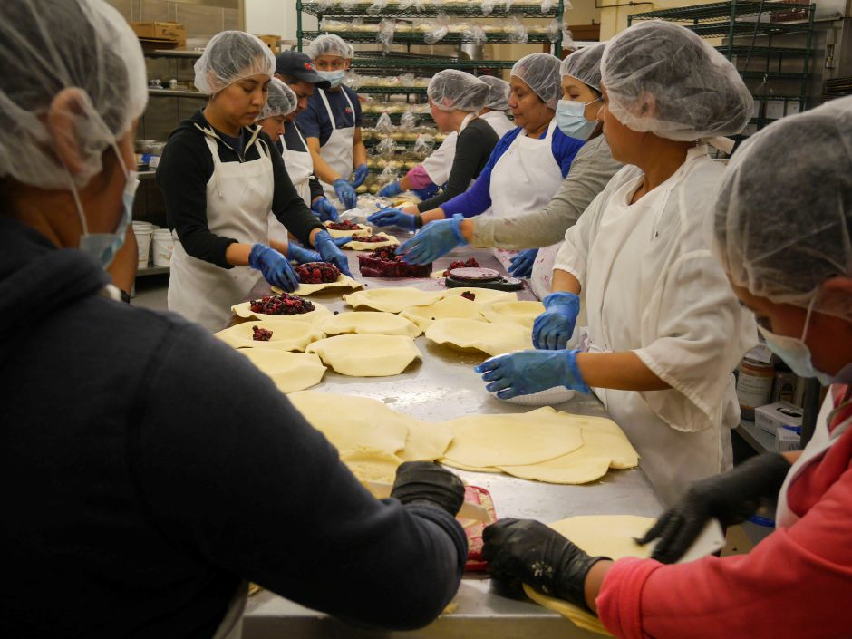Apple Barrel bakery employees assemble pies on March 11, in preparation for the store