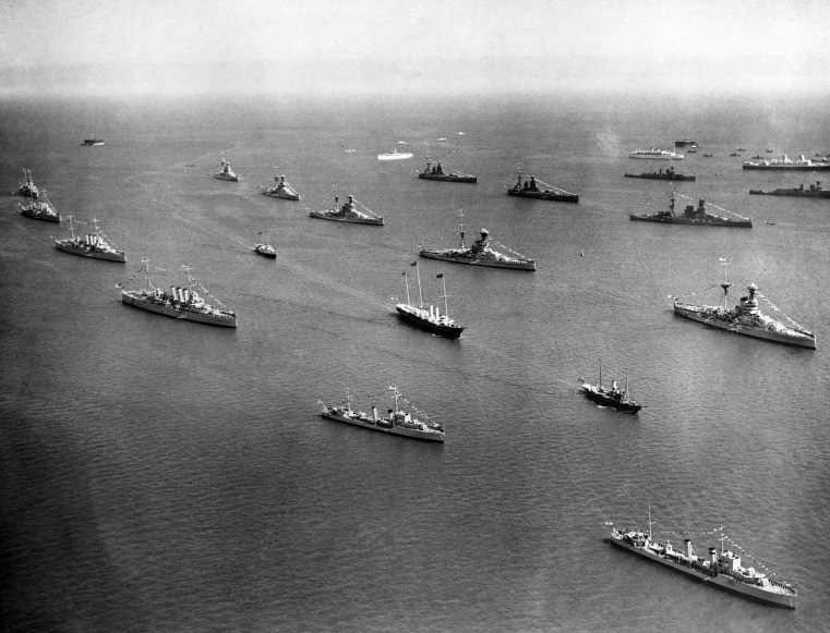 Royal yacht, Victoria And Albert (centre) is preceded by the Trinity House yacht Patricia and followed by the admiralty ship Enchantress, steamed through lines of warships during the Great Naval Review in the Solent off Spithead on July 16, 1935. (AP Photo)