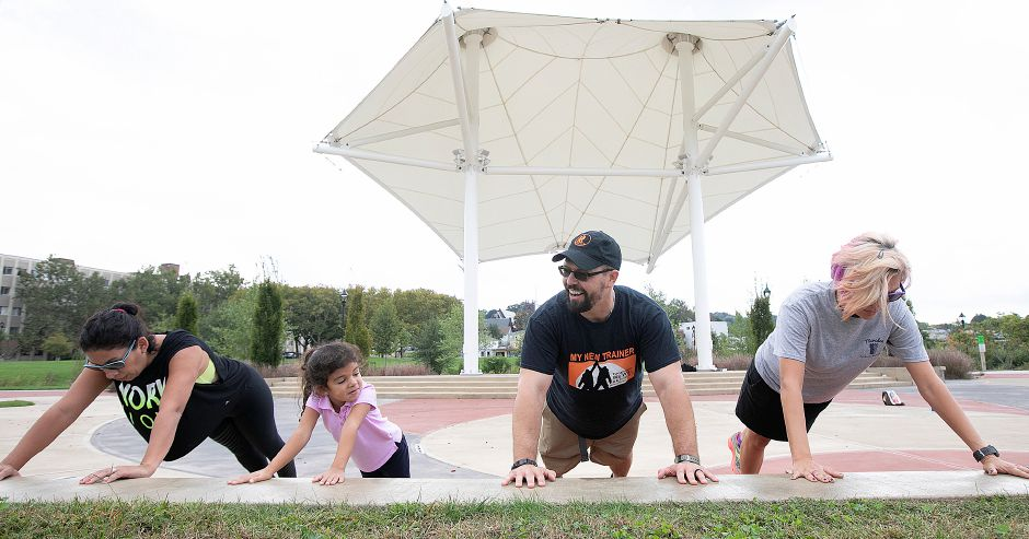 Personal trainer, John Zvonek, of Meriden, stretches with, left to right, Laura Marquet and daughter, Bianca, 4, of Meriden, and Kathy Matula, recreation coordinator, during Meriden Parks and Recreation